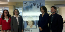Carol Aichele (2nd from L) with a giant mock-up of a Penn State student ID with expiration date.