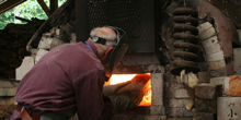 Jack Troy stoking his wood-fired anagama kiln